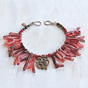 Coral red shapes Om necklace. Cristina Tamames Jewelry Designer