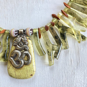 Green shapes of resin coral necklace with  Nepalese Om yellow turquoise pendant . Cristina Tamames Jewelry Designer
