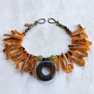 Coral orange shapes with ebony center piece necklace. Cristina Tamames Jewelry Designer