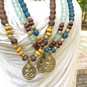 African recycled bottle beads brass Buddha double necklace. Cristina Tamames Jewelry Designer
