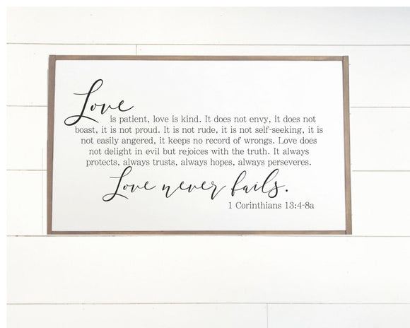 Love Never Fails Framed Wood Sign
