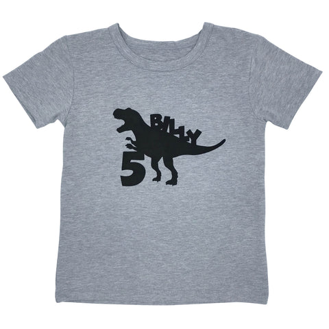 Grey tee with black dinosaur and childs name personalised birthday shirt
