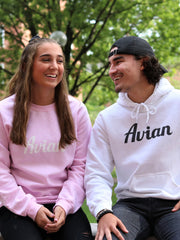 College Girl and Guy sitting down wearing Avian #color_white