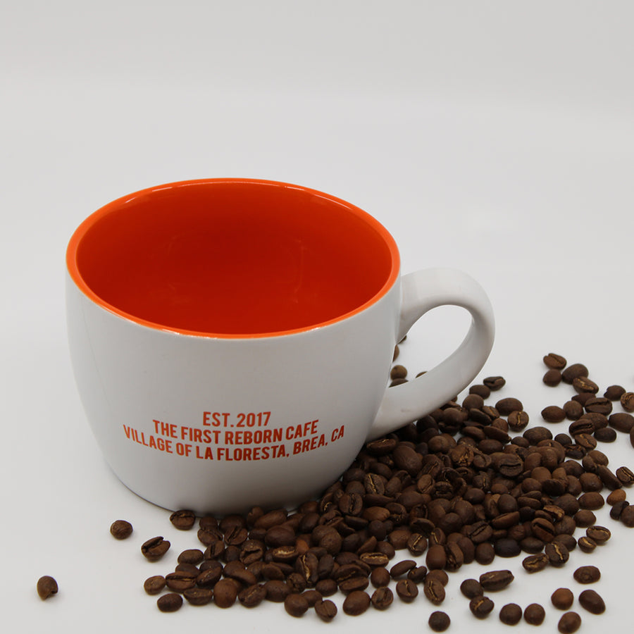REBORN COFFEE MUG-The 1st Reborn Cup. Reborn Coffee Roaster The 1st Reborn Cup.  Coffee Mug. Color: White with Orange. Perfect for Reborn Coffee Fans. Reborn Coffee Roaster's 1st Mug Cup.