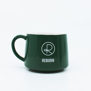 Reborn Coffee Mug Green -Reborn Coffee Roaster Coffee Mug Green -Color: White with Orange -Perfect for Reborn Coffee Fans. Brea, California Printed.