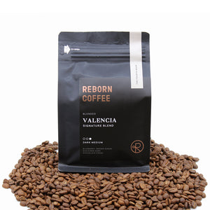 A symphony of Colombian, Mexican, Guatemalan, and Ethiopian. Roasted for espresso and drip coffee, the Valencia blend combines elements of all of our world class beans to provide the perfect signature blend. Amazingly balanced, full bodied, nuanced and packed with flavor.    This Coffee Gift set includes 1 Reborn Coffee House Blend Valencia coffee Bean and 1 Reborn Coffee ORANGE COUNTY Coffee Mug.