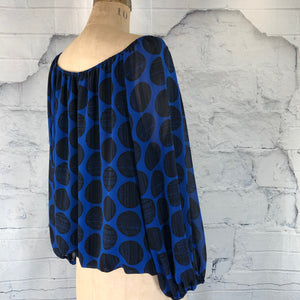 Vince Camuto blue blouse with black circle