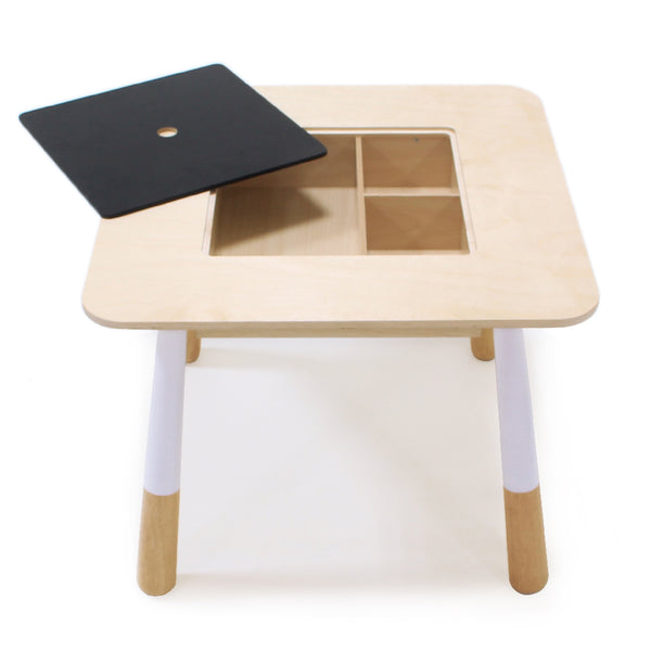 Tender Leaf Toys wooden table for children with a hidden compartment to store crayons and art equipment or toys