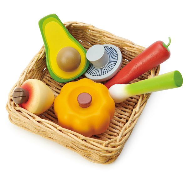 A super healthy veggie basket to be played with our market stall. A hand crafted wicker basket filled with a pumpkin, turnip, mushroom, chilli pepper, avocado, and leek. Part of our Market day Range and an accessory to our gorgeous Farmers Market.