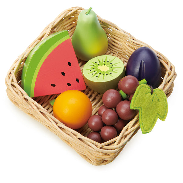 A selection of fruits from round the world, all in a hand crafted wicker basket, Set includes, bunch of grapes, half a kiwi fruit, slice of watermelon, pear, plum, and tangerine. Part of our Market day Range and an accessory to our Farmers Market.
