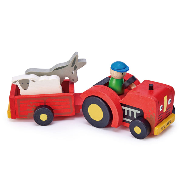 Tender Leaf Toys wooden tractor and detachable trailer set in bright red