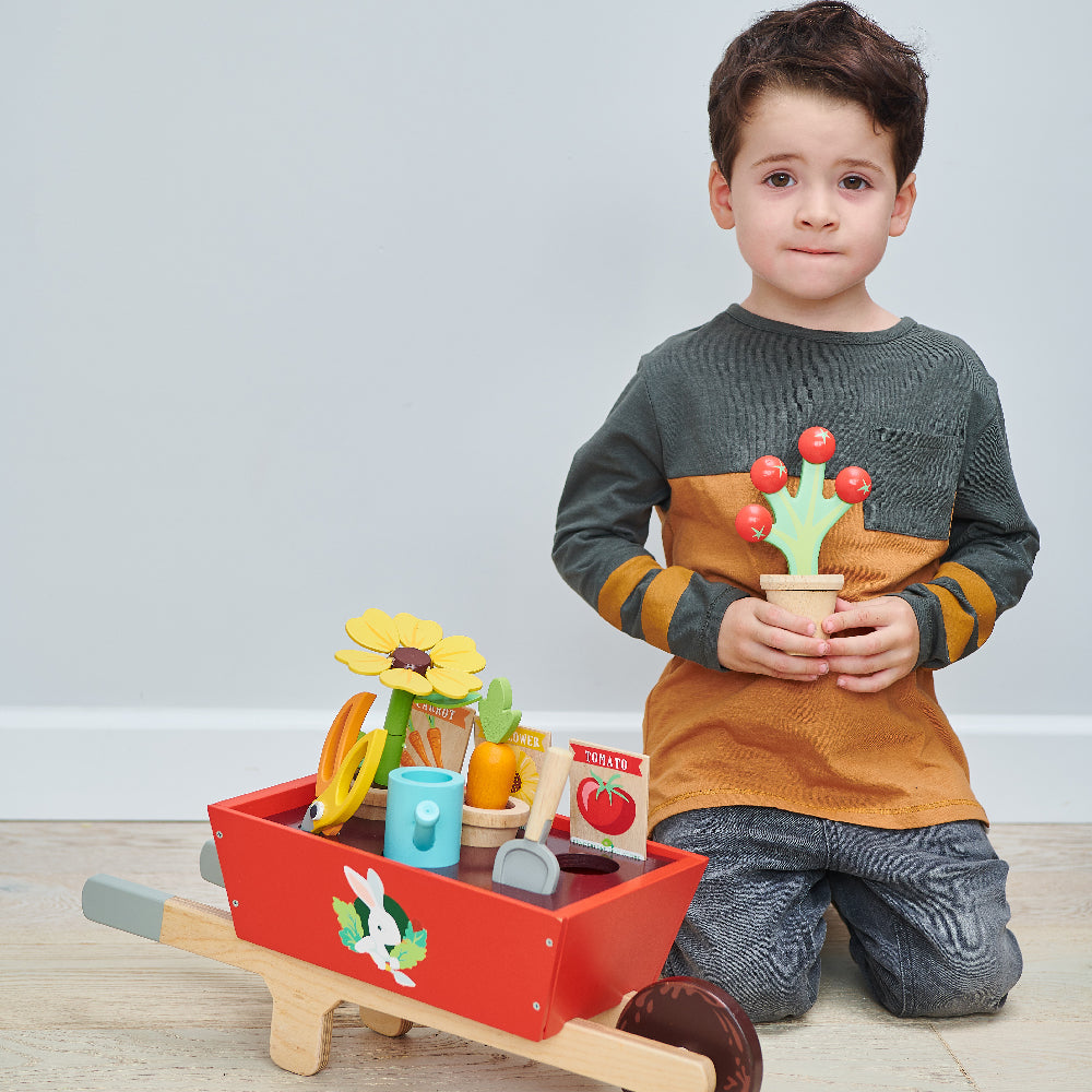 Tender Leaf wooden toy garden wheelbarrow with flowers