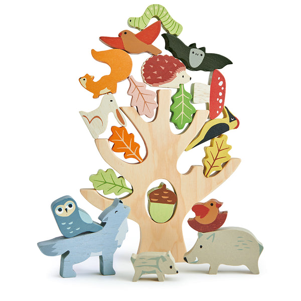 tenderleaf toys wooden stacking tree trunk with animals including an owl, a bat, a wolf, a squirrel, a woodpecker, an acorn, a mummy pig with her baby, a caterpillar, five leaves, a toadstool, a moth, a rabbit, a hedgehog, a bird, and a bird in a nest completely plastic free