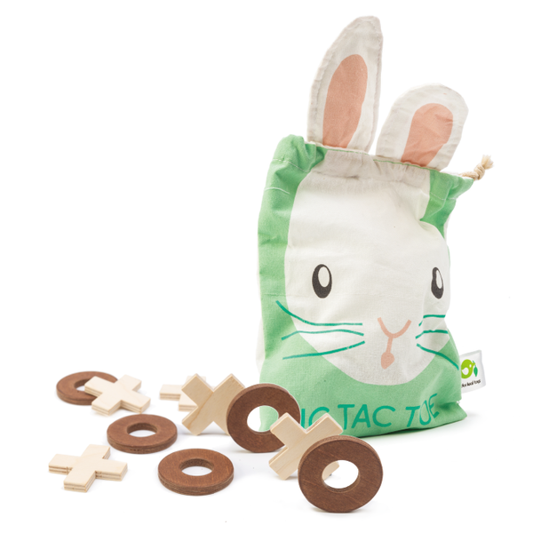Tender Leaf Toys wooden tic tac toe game with 5 wooden crosses and 5 wooden circles and a bunny drawstring bag