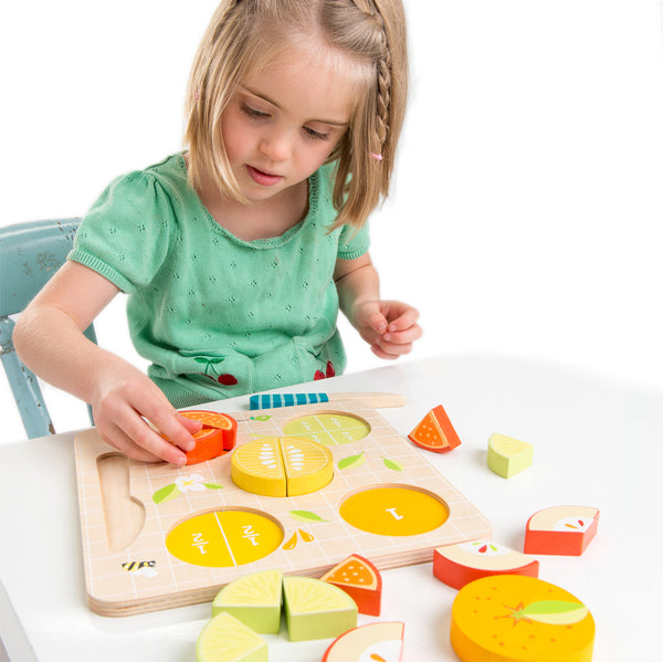Tender Leaf Toys wooden 16 piece puzzle and knife to learn all about fractions