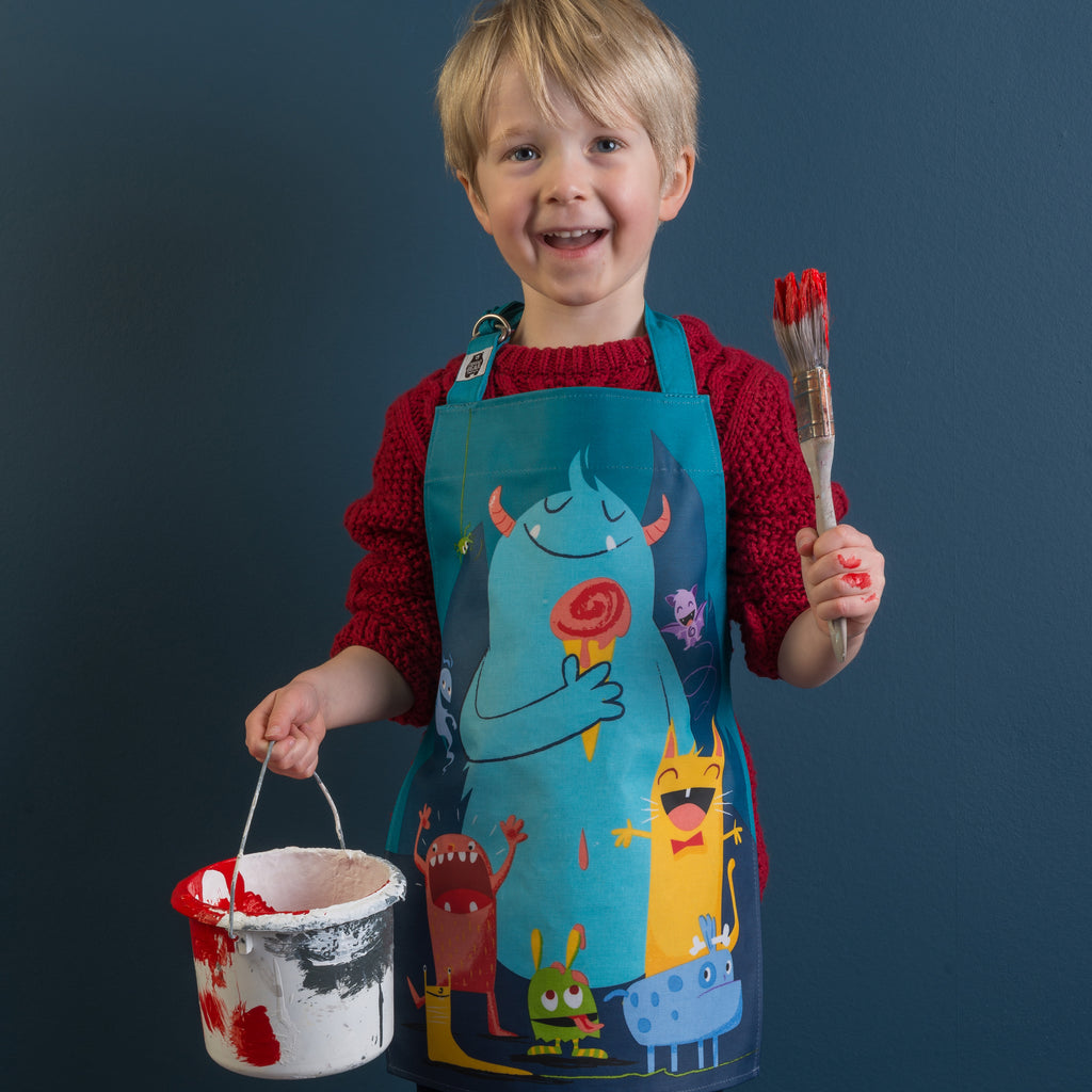ThreadBear Design Biodegradable Apron. This TPU coated cotton apron has our own gang of monsters illustrated on the front
