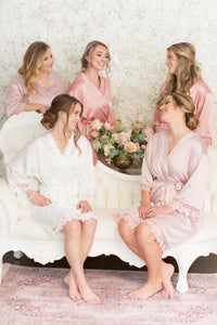 Bride surrounded by her bridesmaids in their pearl and silver earrings