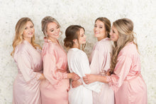 Bride and bridal party wearing crystal and pearl earrings