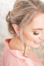 Bridesmaid wearing crystal stud earrings