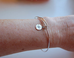 lady wearing compass bracelet on wrist