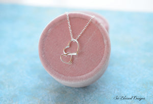 Sterling silver heart necklace on display