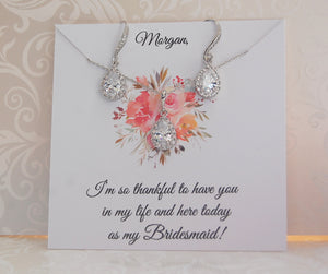 Silver bridesmaid jewelry set on personalized card