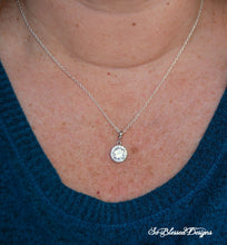 lady wearing cz round necklace