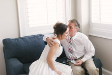 bride hugging dad after giving him always little girl gift