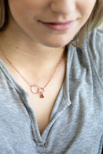 girl wearing rose gold necklace