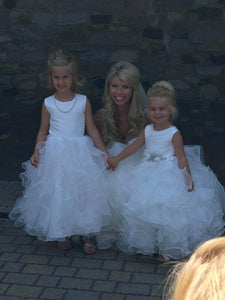 Bride with 2 flower girls wearing necklaces