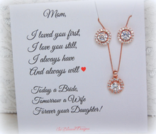 Rose gold set earrings necklace displayed on I loved you first card