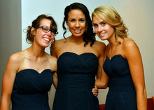 Bridesmaids wearing their infinity pearl necklaces for wedding