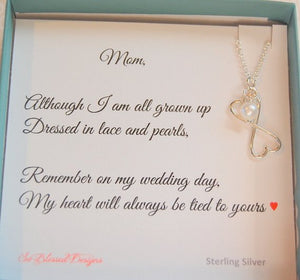 Hearts necklace on card Although I am all grown up dressed in lace and pearls remember on my wedding day My heart will always be tied to yours