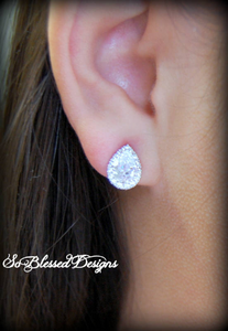 Bridesmaid wearing silver teardrop stud earrings for bridesmaids gift