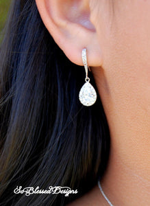 bridesmaid wearing silver teardrop earrings
