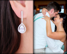 Long Stunning Teardrrop Earrings worn by bride on wedding day