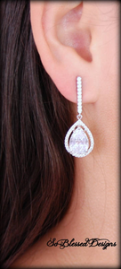 Silver long teardrop earrings worn by bride