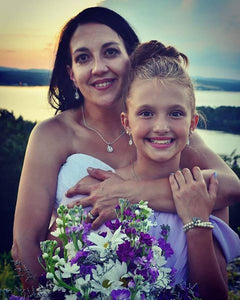 Bride wearing Teardrop CZ necklace on her wedding day with junior bridesmaid