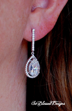 Sterling silver and CZ long earrings worn by bride on wedding day