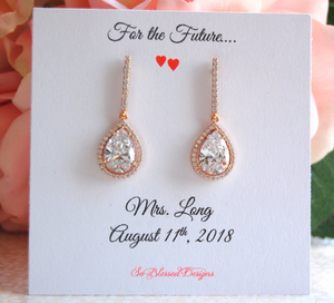 Rose gold teardrop earrings displayed on future Mrs jewelry card