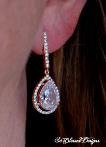 Bride wearing rose gold teardrop earrings on wedding day