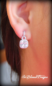 Bridesmaid wearing square cubic zirconia earrings