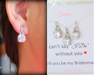 bridesmaid wearing earrings and necklace on wedding day