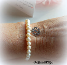 Mother of the Groom wearing pearl bracelet from bride