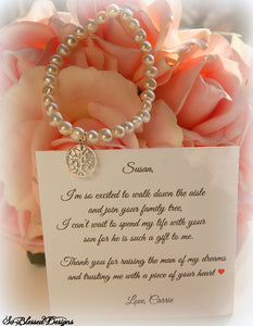 Personalized mother of the groom pearl bracelet displayed on thank you jewelry card