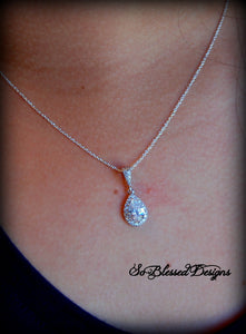Mother of the Bride proudly wearing silver teardrop necklace