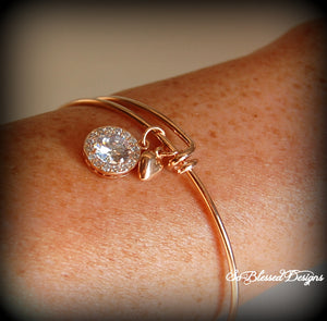 Motherof the groom wearing rose gold cubic zirconia bracelet