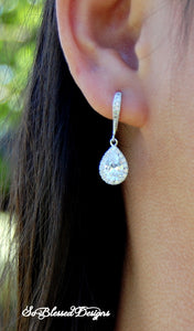 Beautiful bridesmaid wearing silver teardrop earrings for wedding