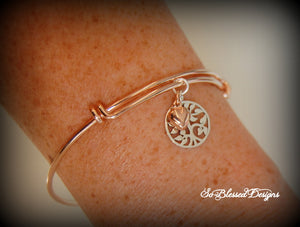 New sister in law wearing rose gold family tree bracelet