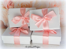 Wrapped gift boxes for bridesmaids of their teardrop earrings